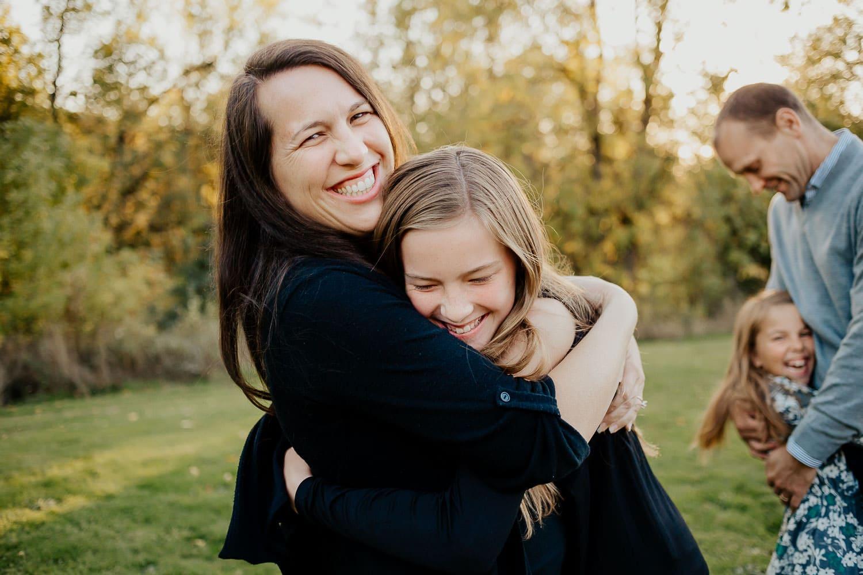 Mom and daughter hugging in Clackamas Oregon