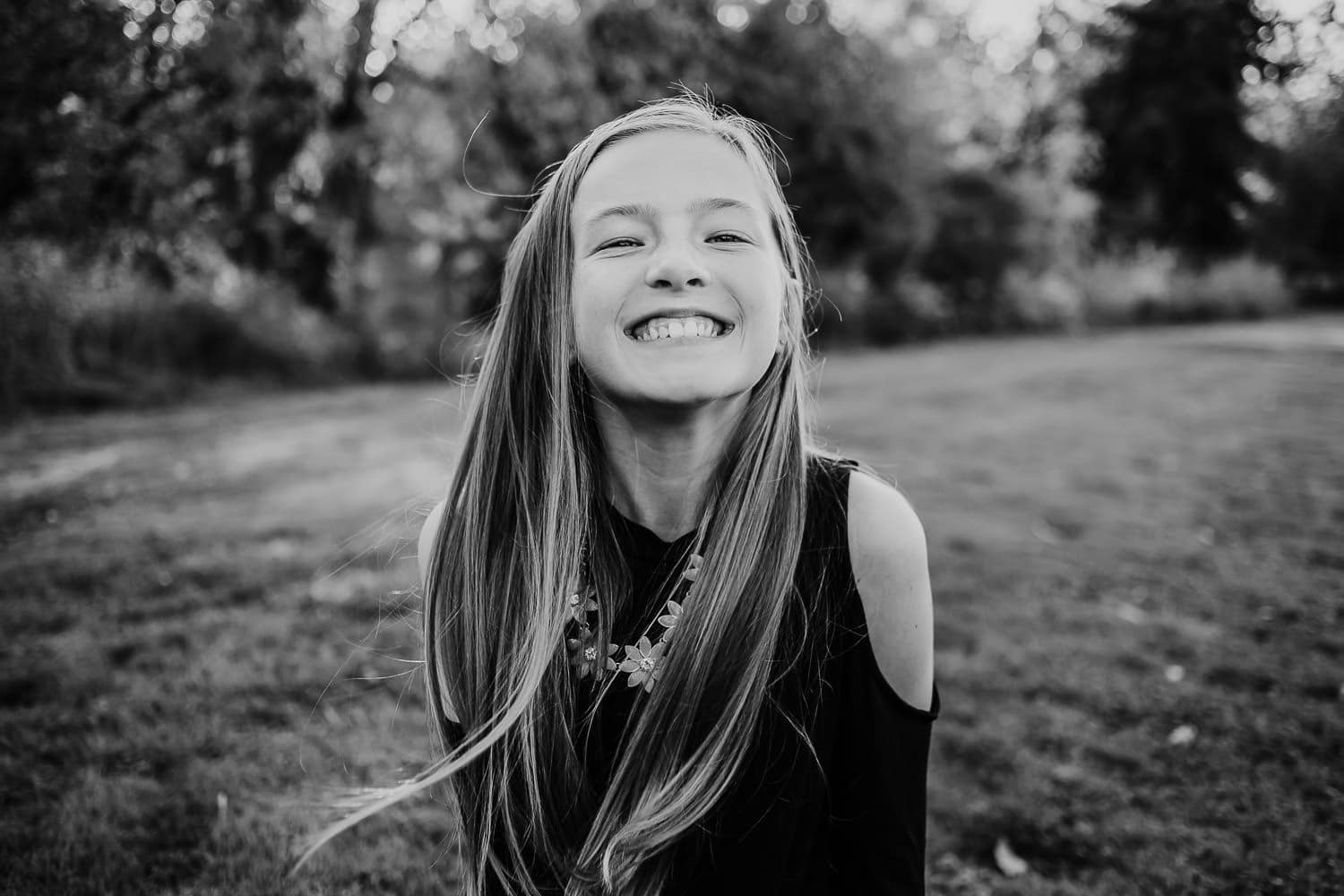 Pre-teen girl laughing at the camera