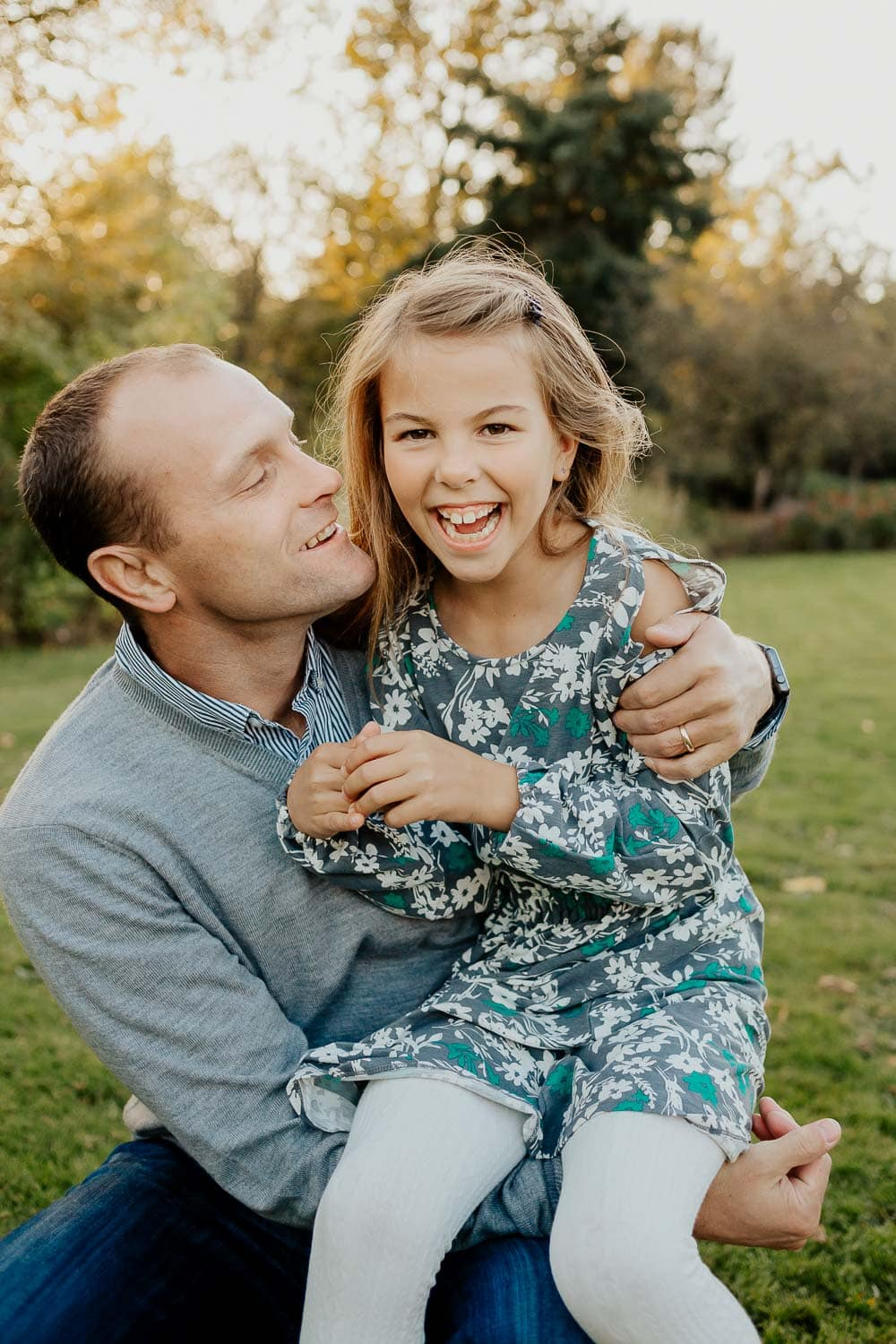 Dad and daughter laughing together - family photographer in Portland Oregon