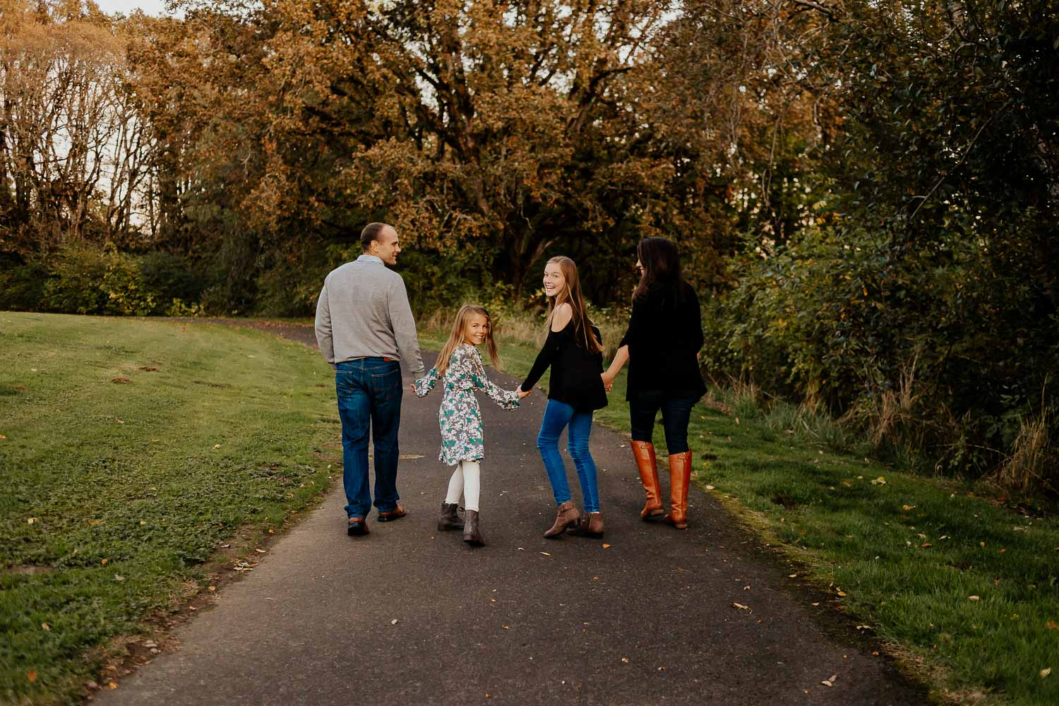 Family walking and holding hands in clackamas near portland oregon