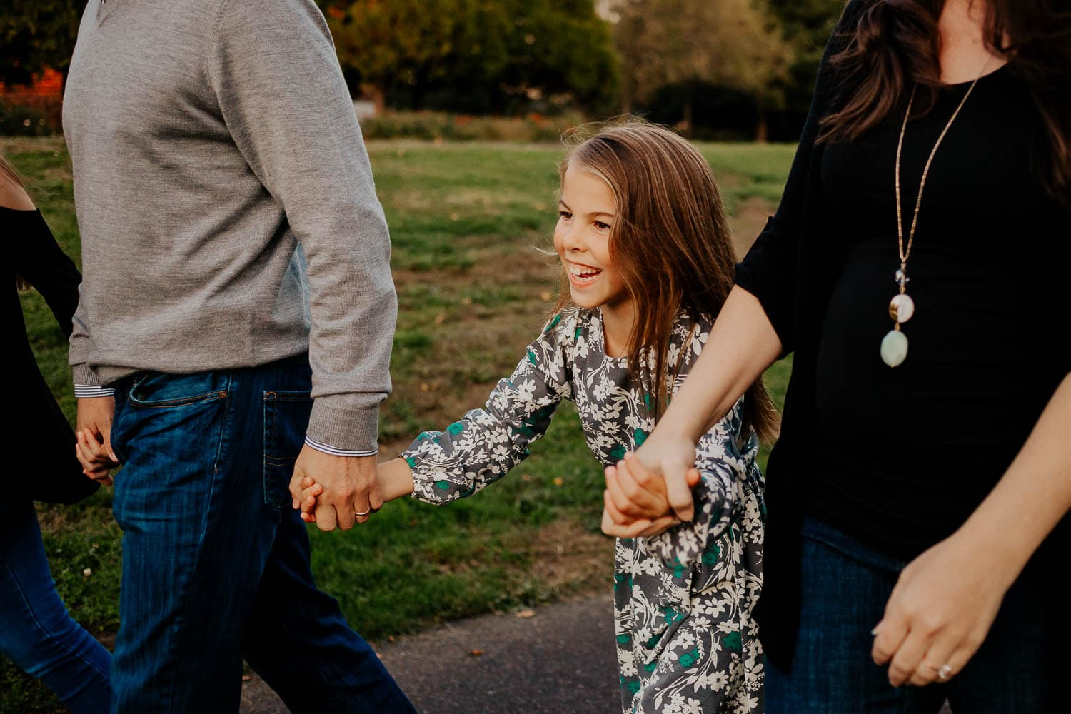 Family walking and holding hands in clackamas oregon