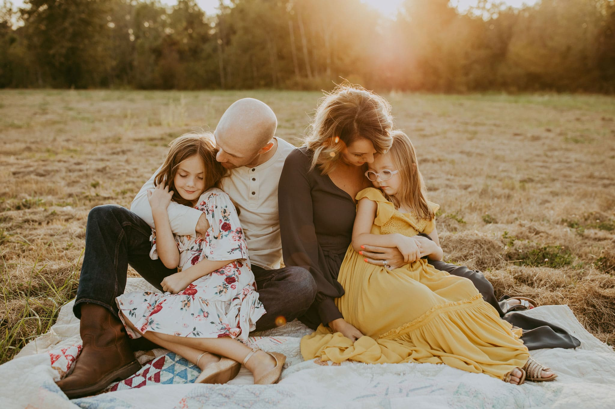 Sweet family cuddling on blanket - pdx lifestyle photography
