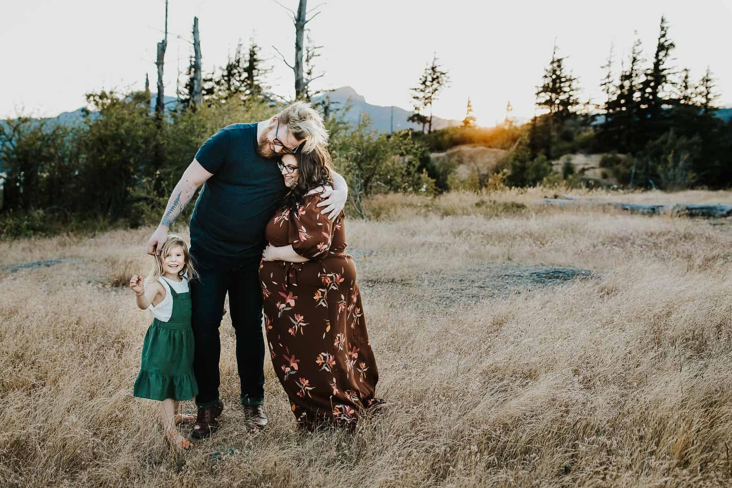 family cuddling and looking happy - maternity photographer
