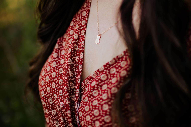 Closeup of moms necklace three arrows