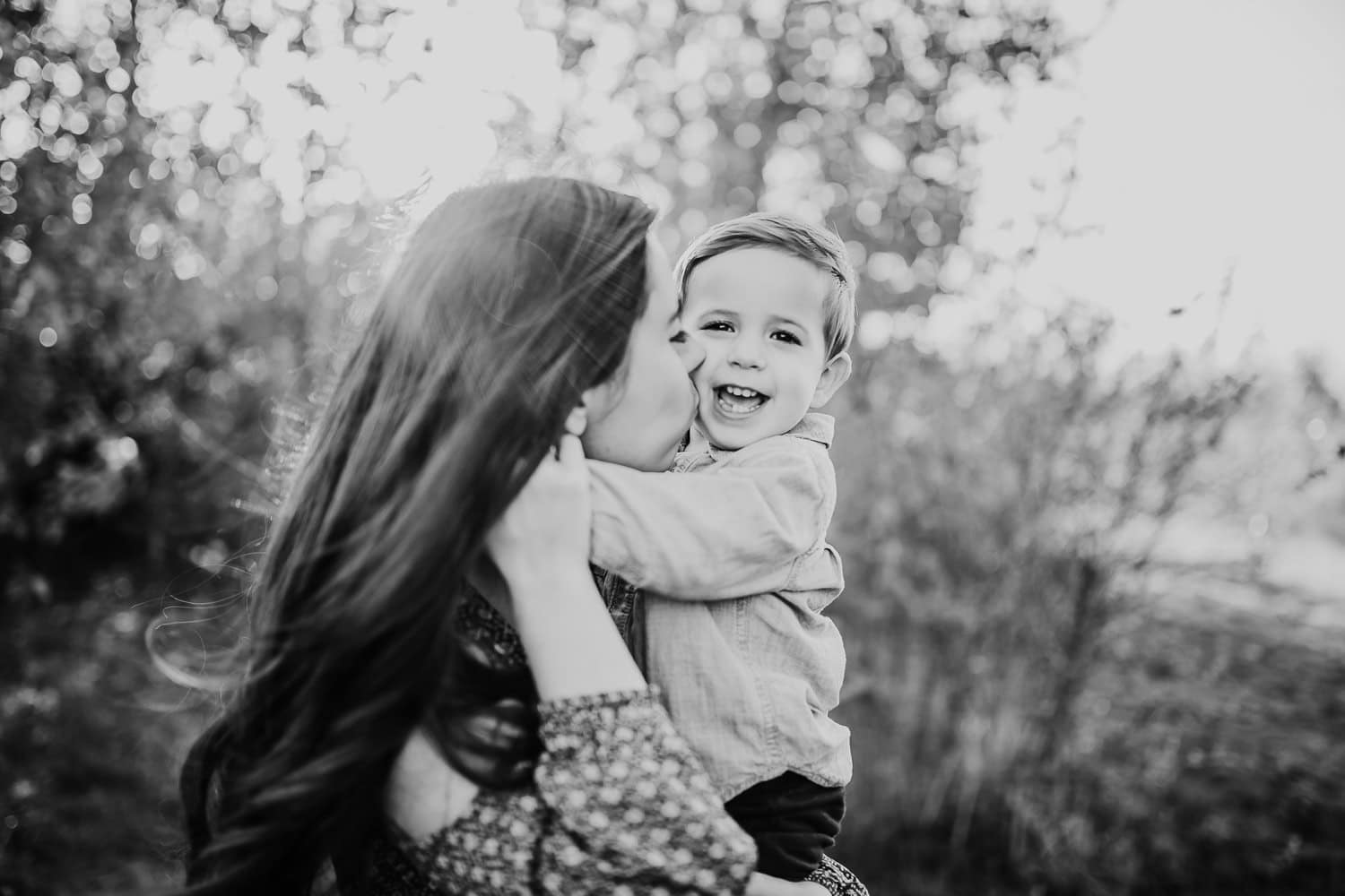Mom kissing sons face in PDX - Family Photographers
