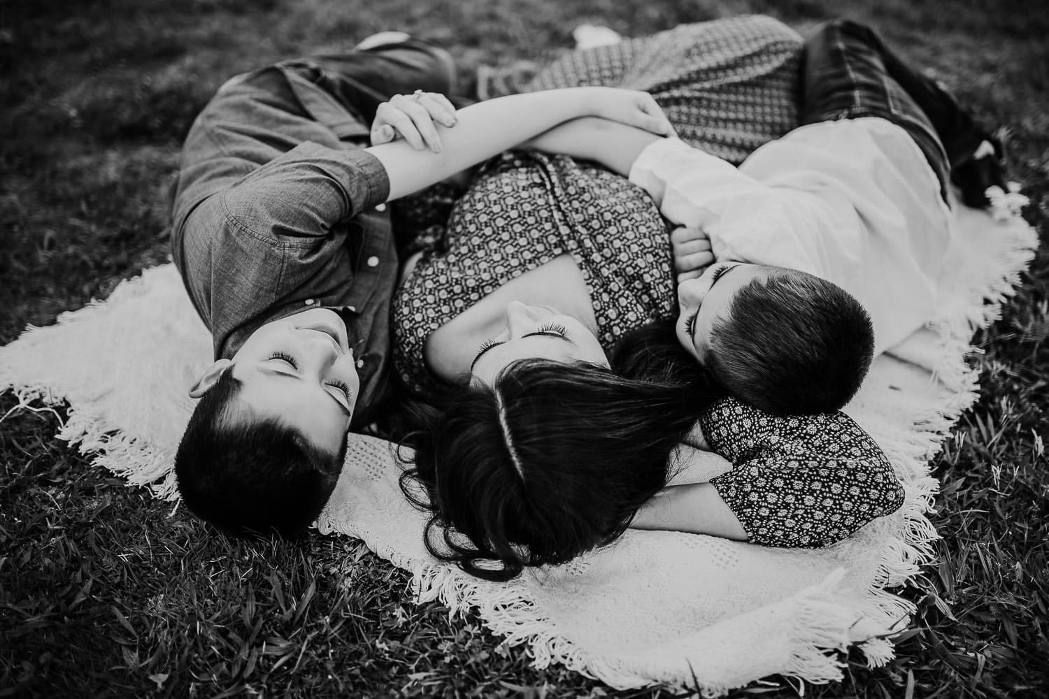 Mom laying on blanket with two sons - Portland Oregon family photographer
