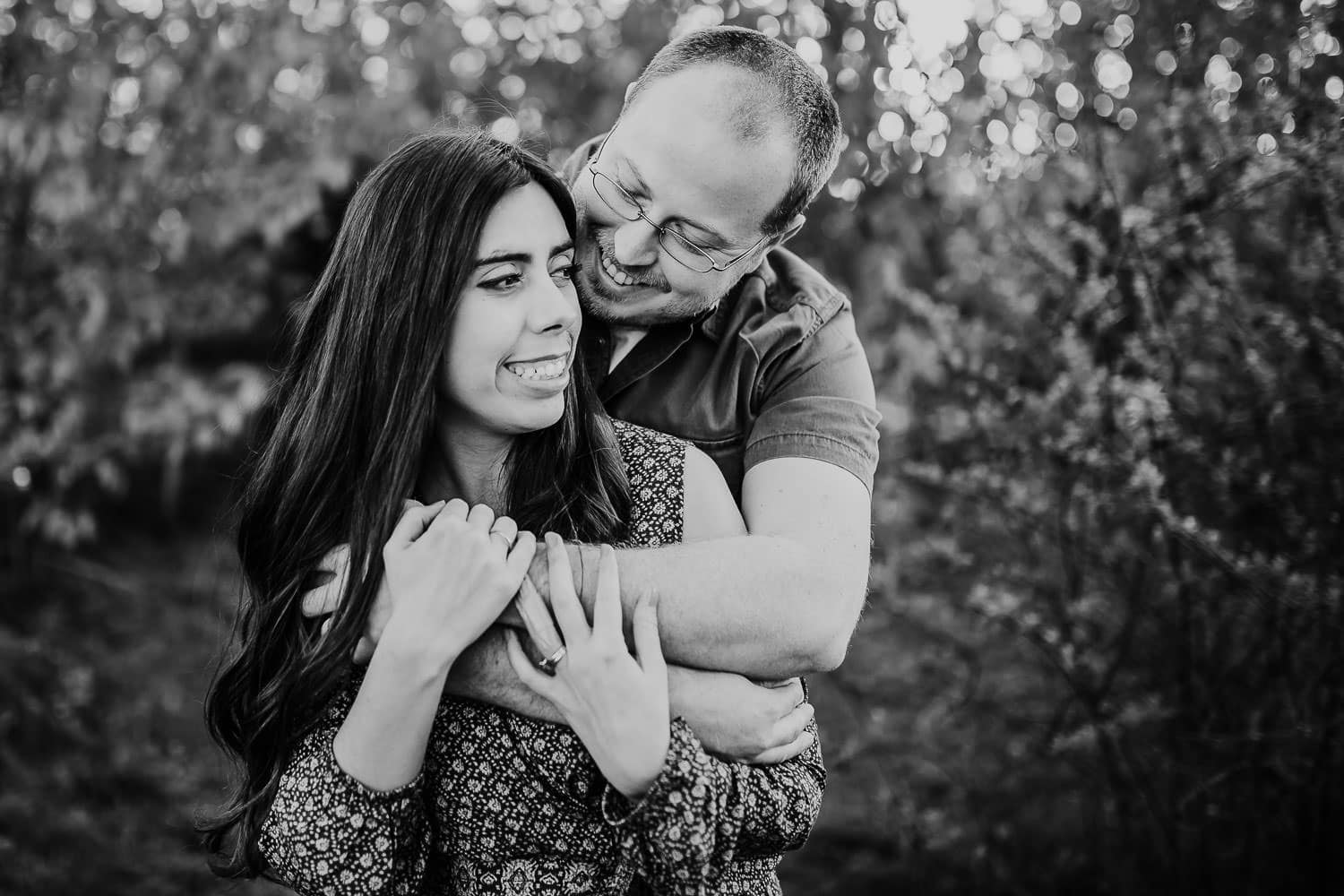 Couple embracing and laughing - Portland oregon