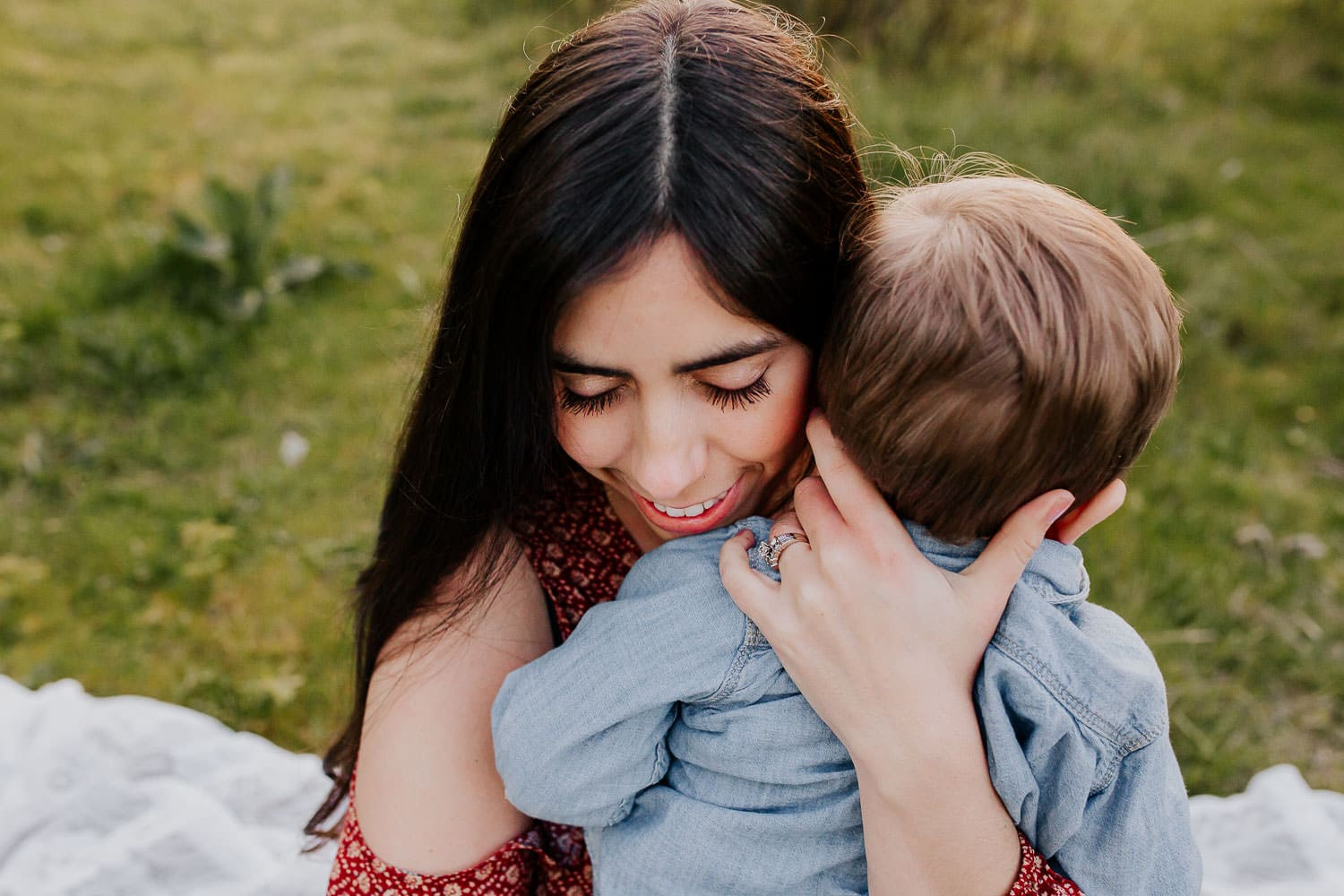 Mom holding toddler son close to her