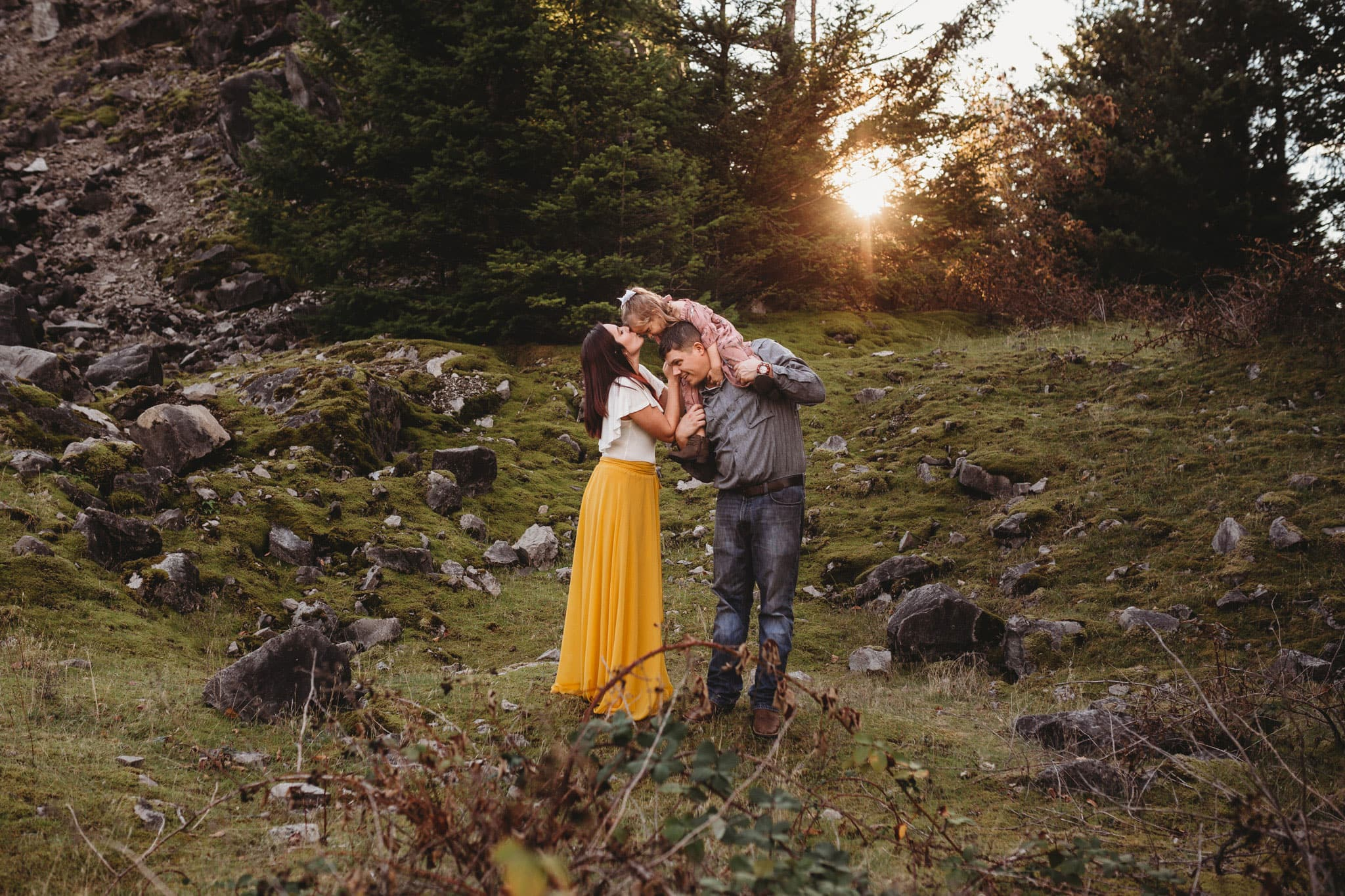 sweet family in nature with a sunburst