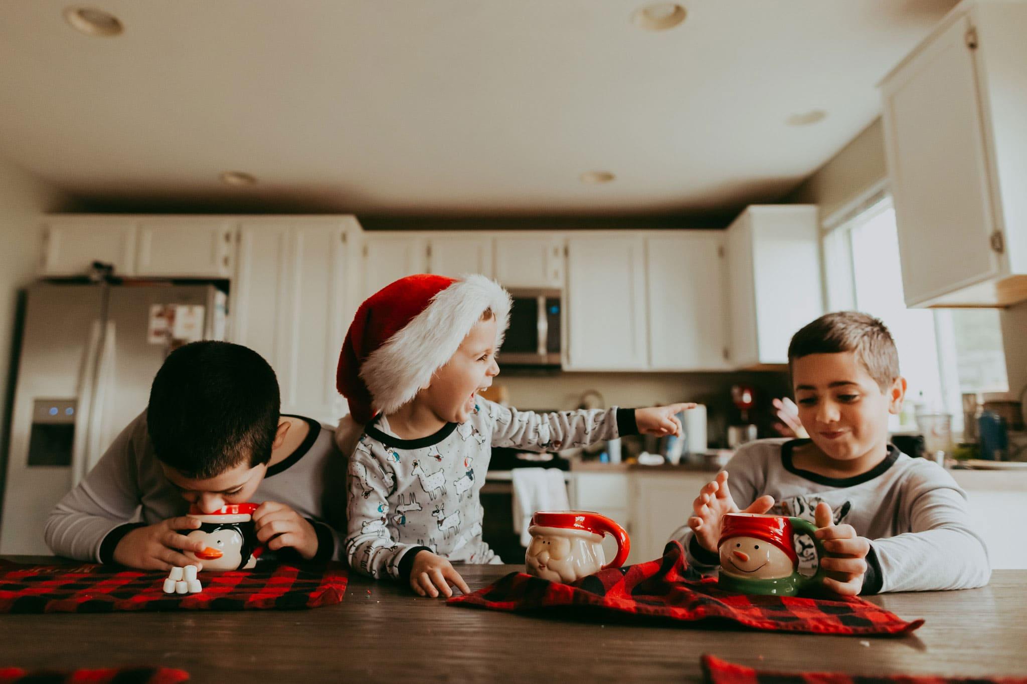 three boys drinking hot cocoa at christmas - family photography