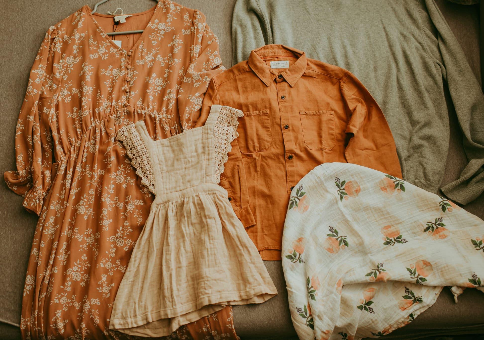 clothing laid on a bed   Jamie Kay dress,  zara shirt, Roolee dress