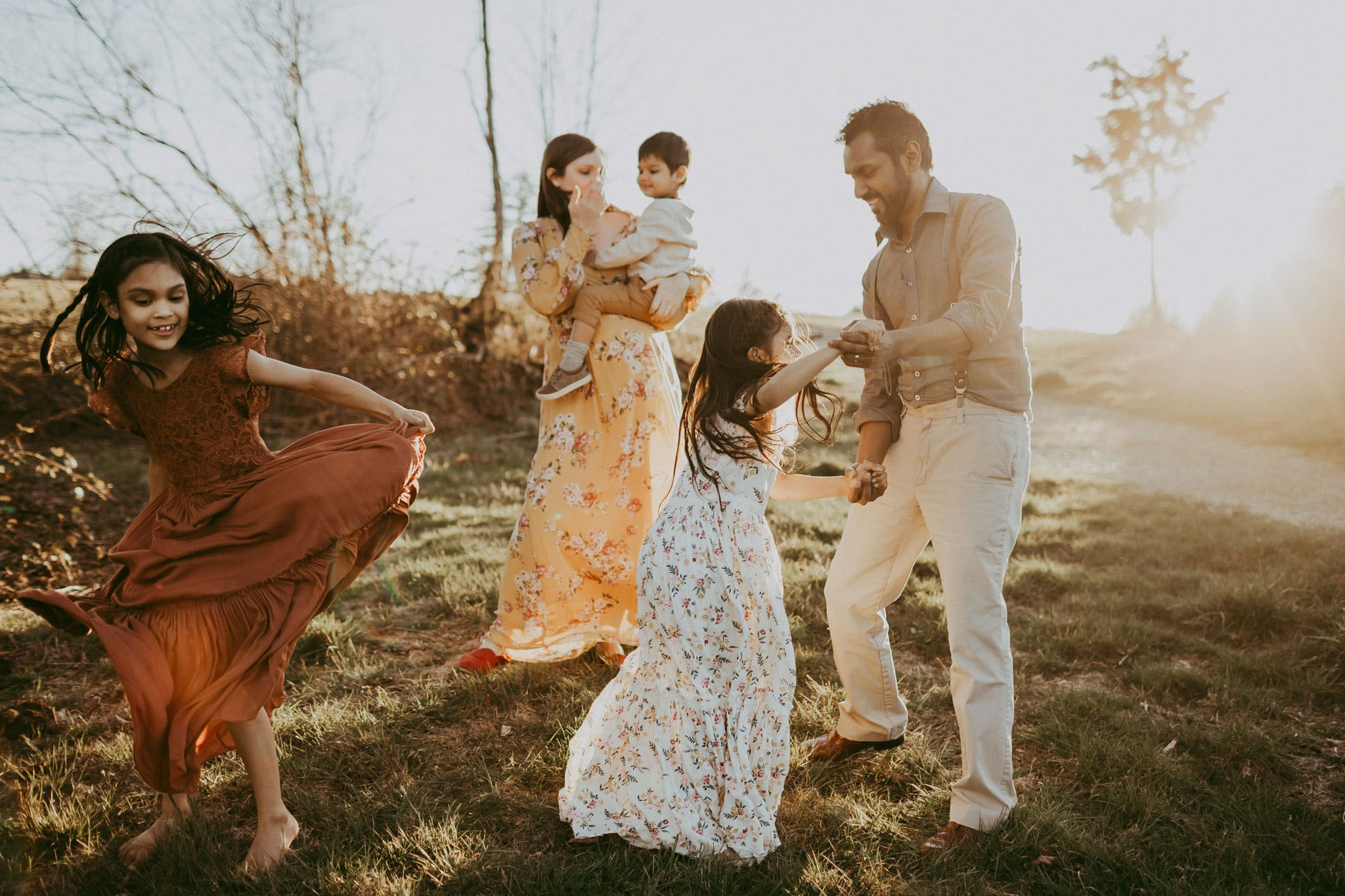 family dancing during their Lifestyle Maternity Family Photography session in gresham oregon