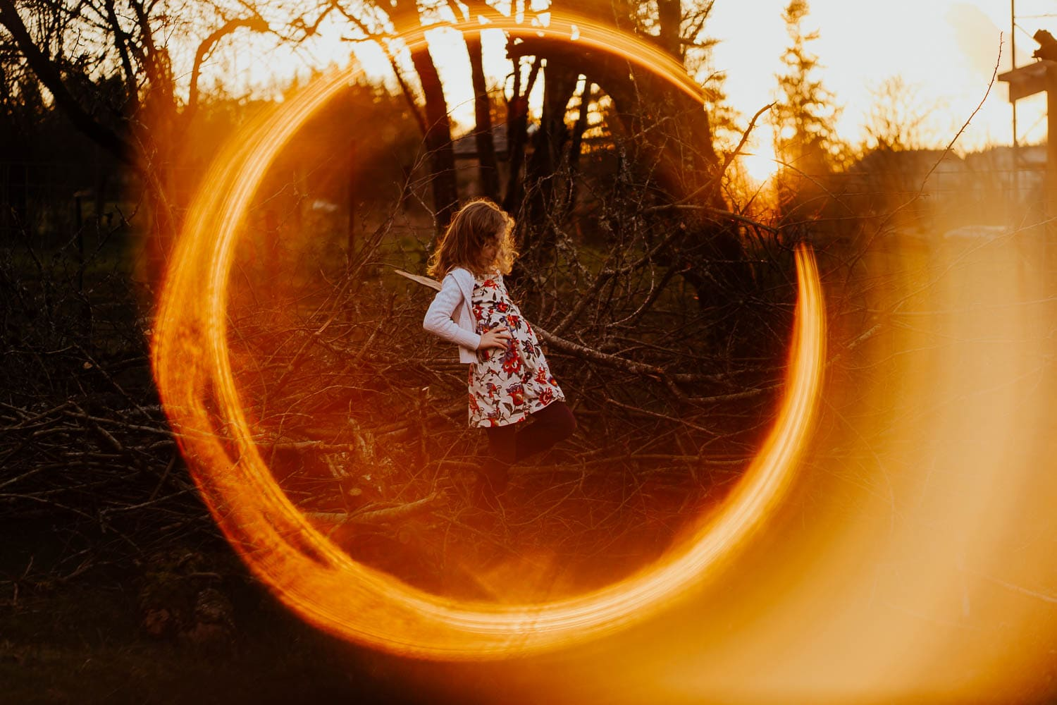 Little girl outside with ring of fire around her - photography tutorial