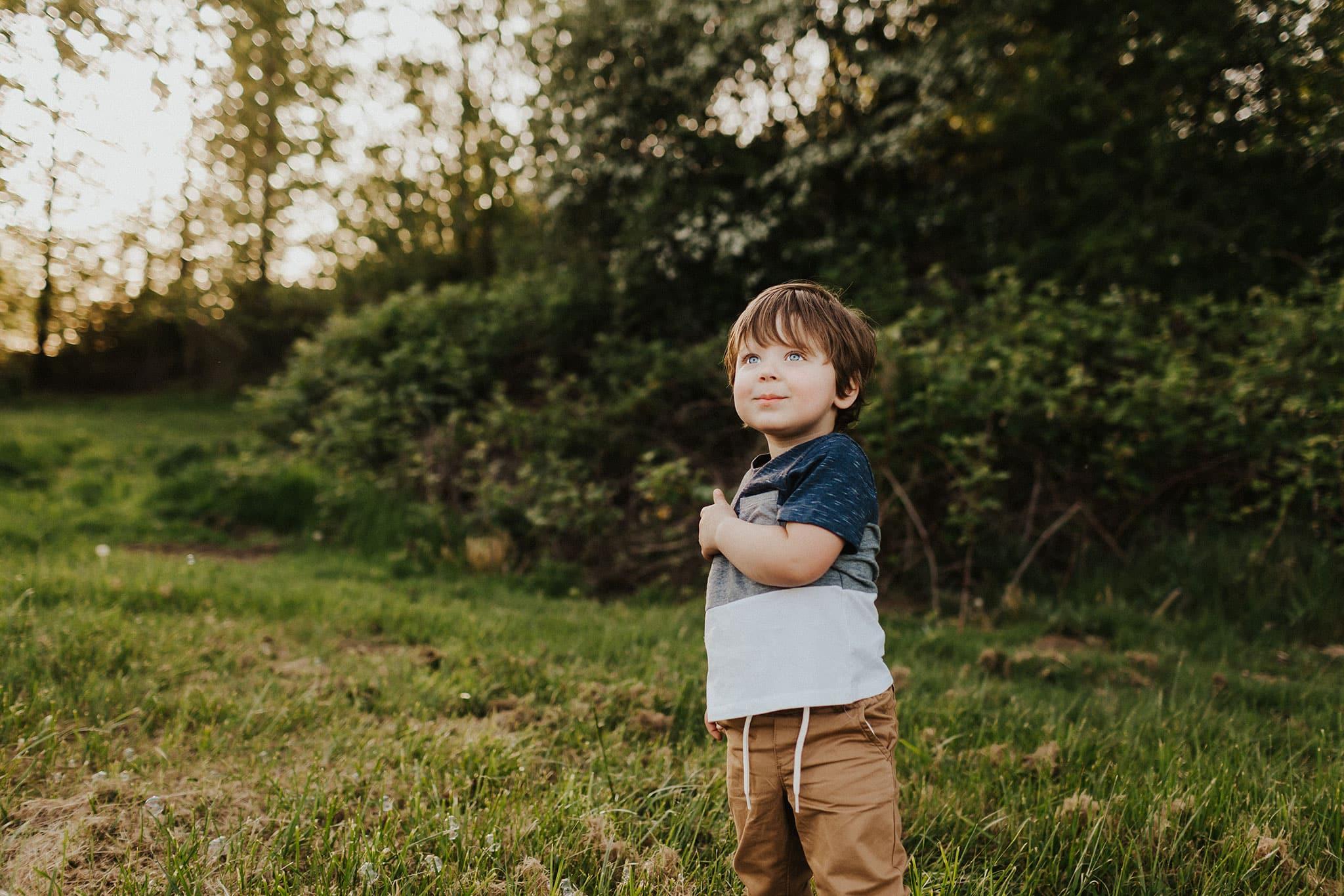kid standing in field in pdx