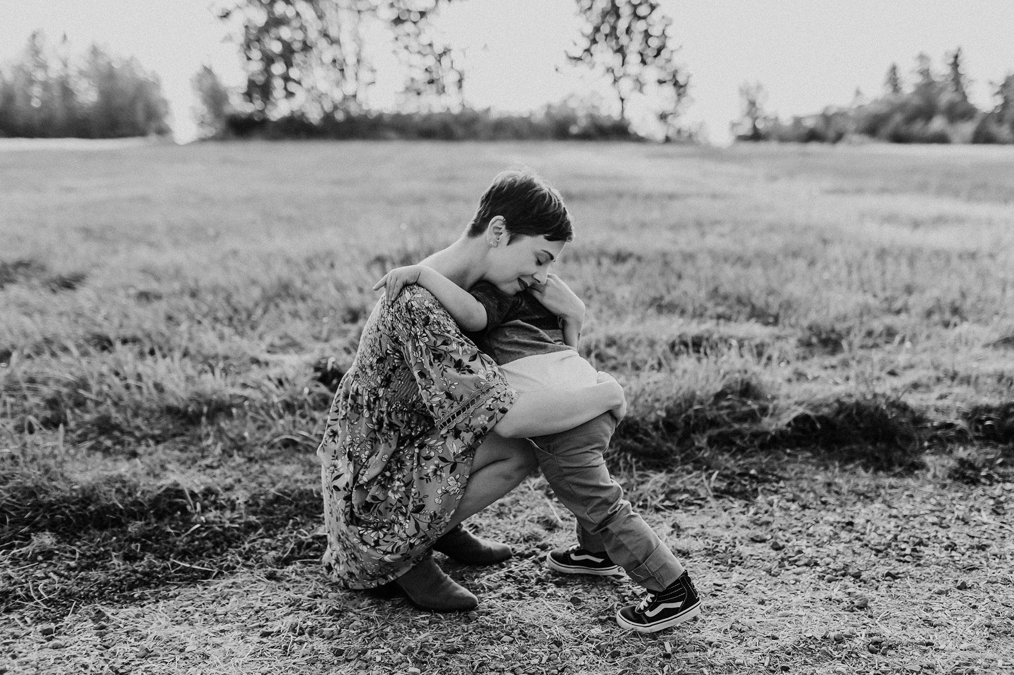 mom and boy hugging