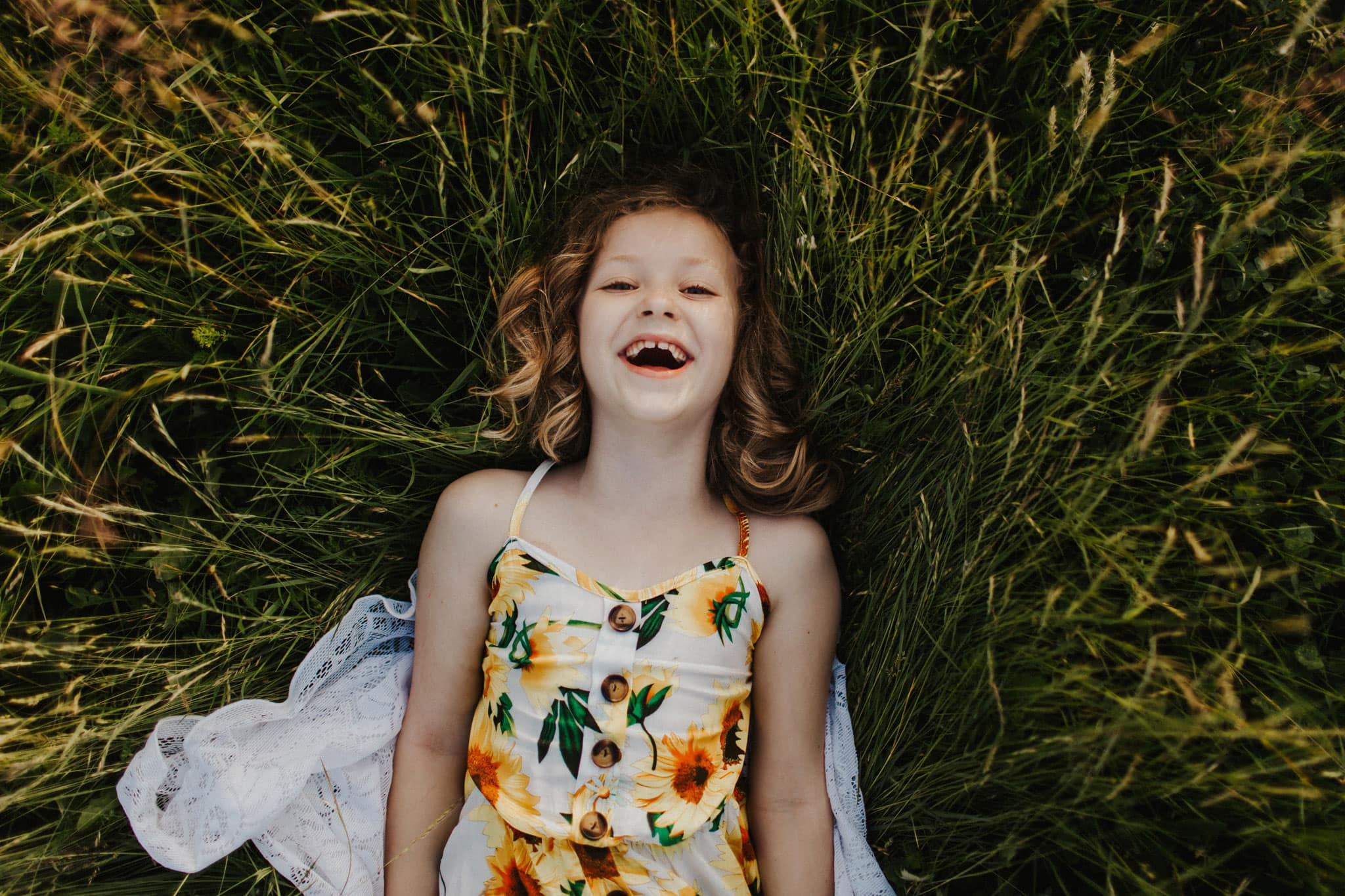 portland oregon child laughing in grass