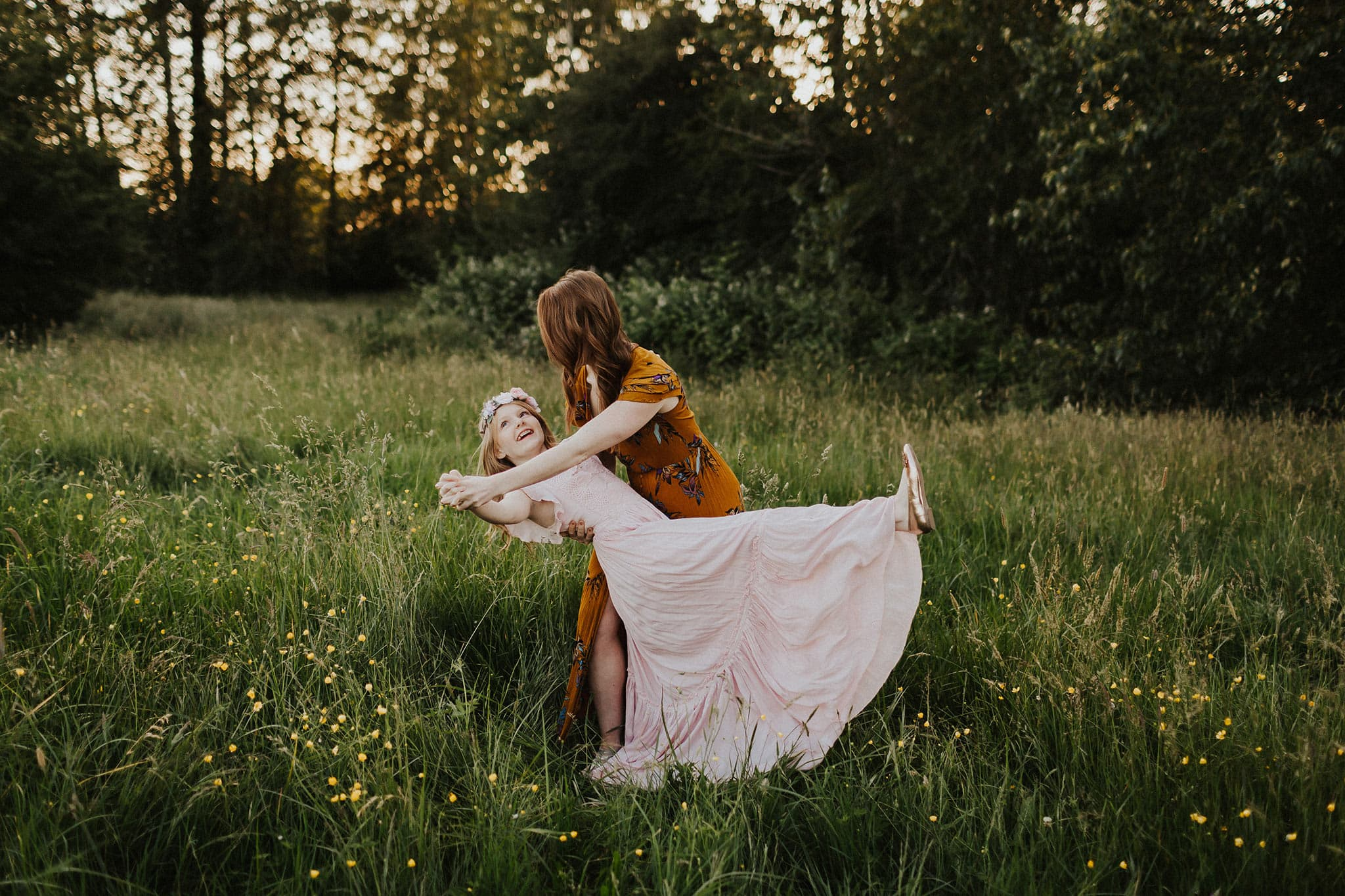 mom and daughter dancing together - family photographers in portland oregon