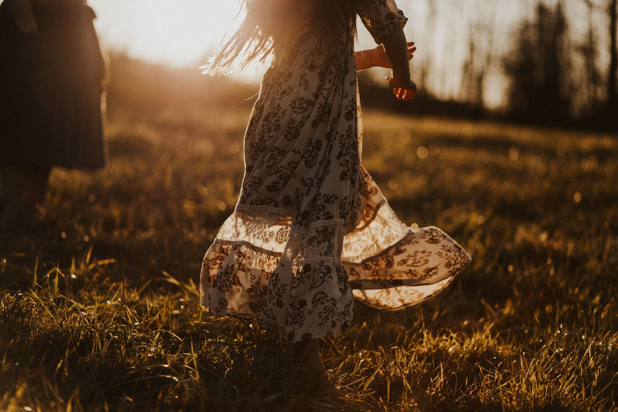 portland oregon - girl spinning in dress with the sun behind her - winter season family photography