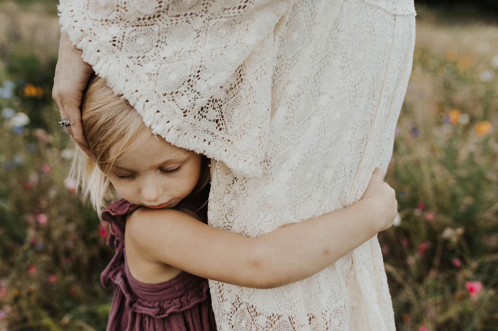 little girl hugging onto mom during family photos