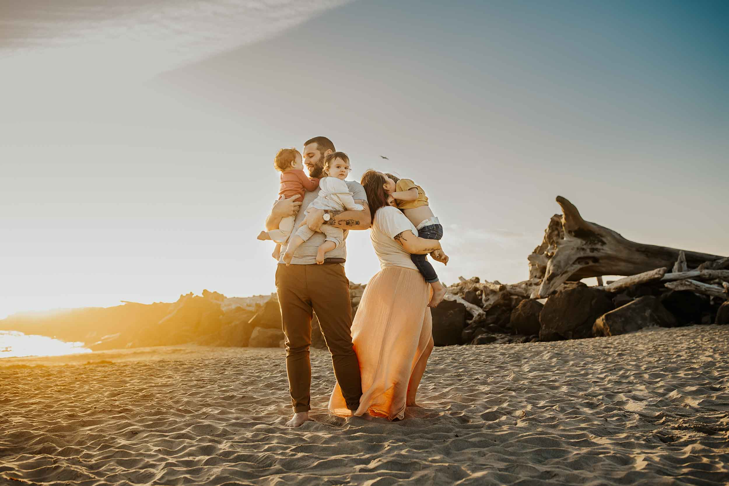 Family of five hugging in the sunset on the beach - oregon coast family photographer