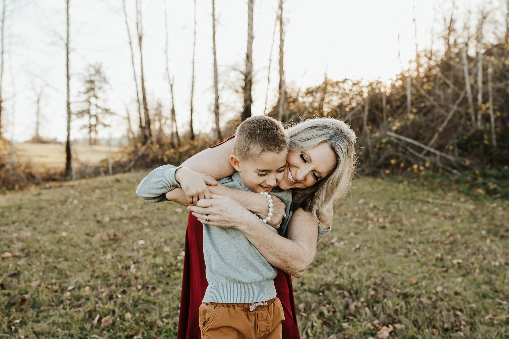 mom cuddling son in a candid moment