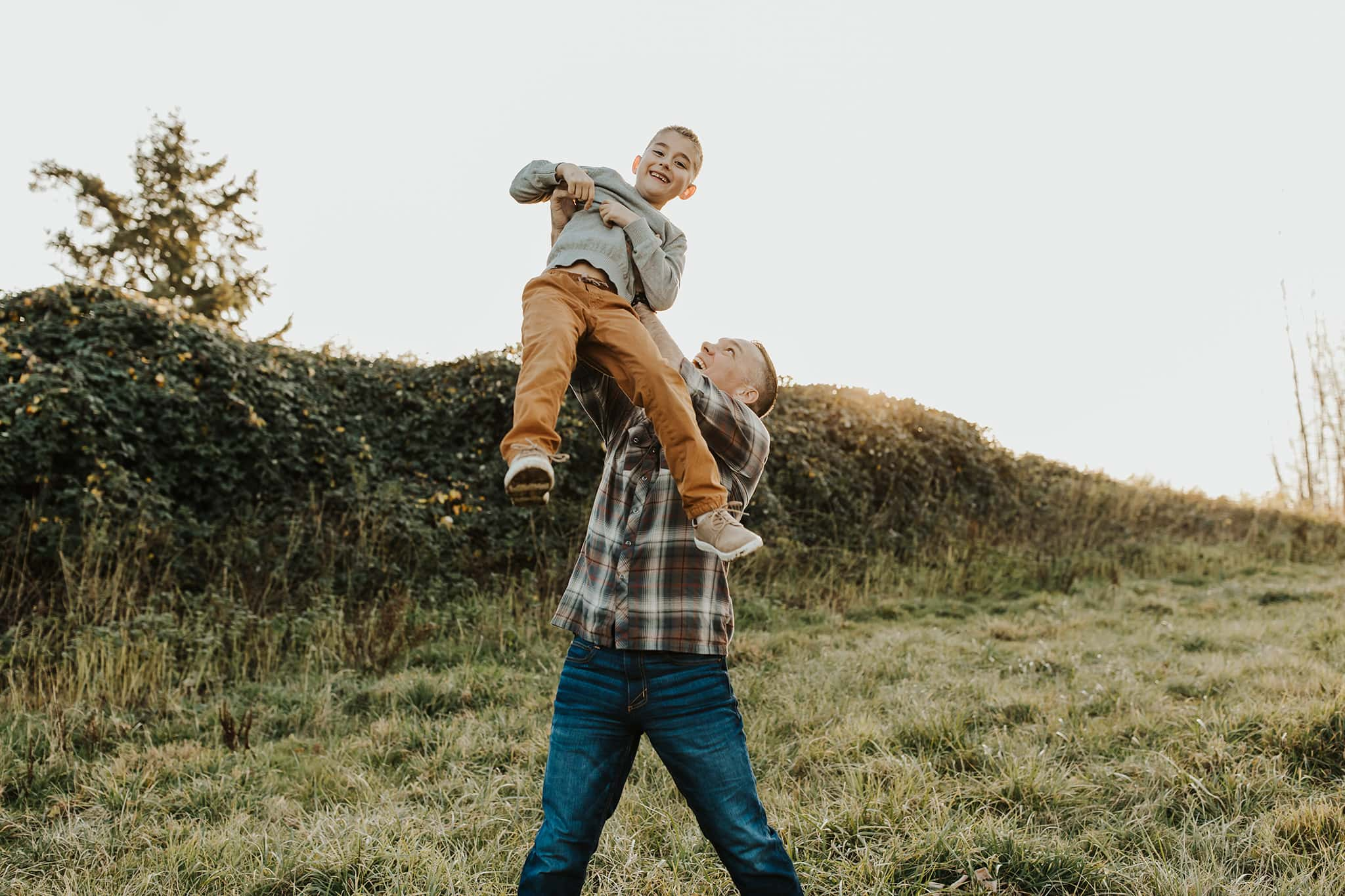 Dad throwing son in air