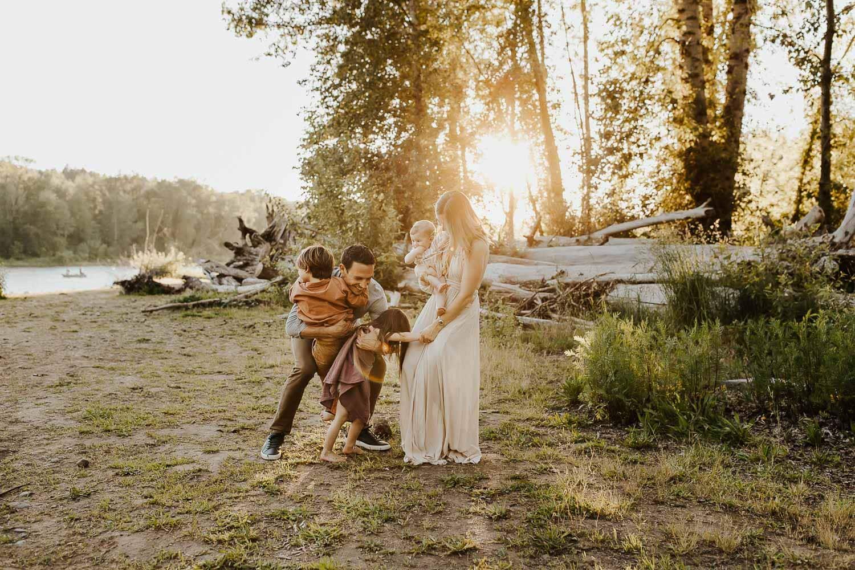 family hugging in beautiful light