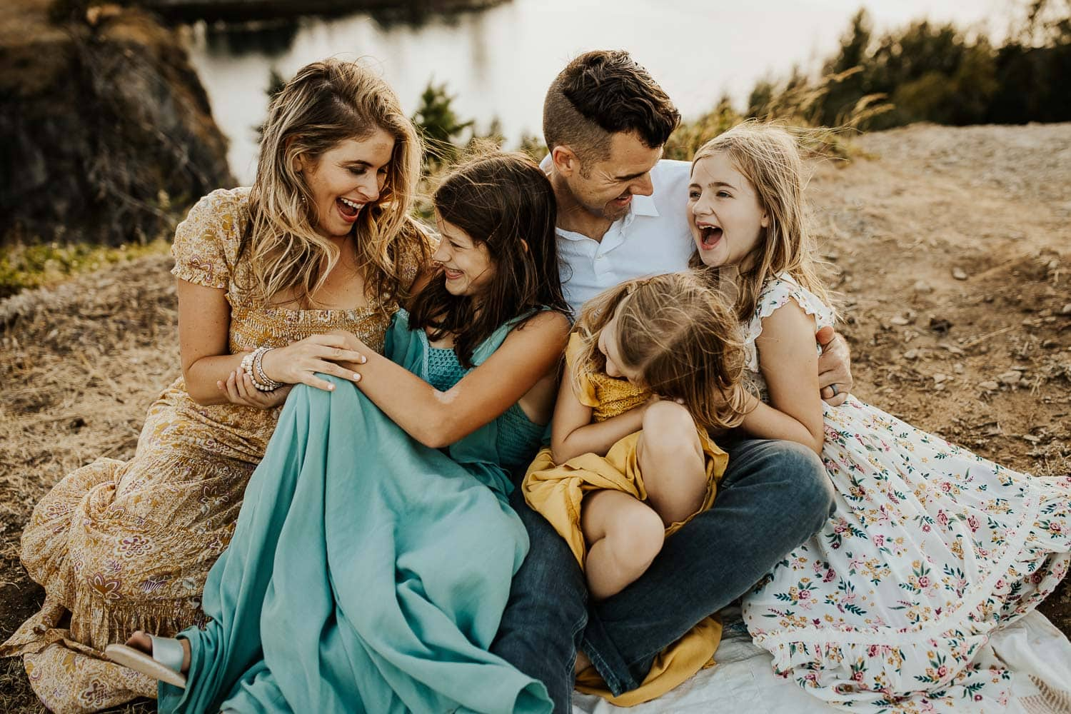 Laughing family on blanket in the columbia river gorge by Portland oregon