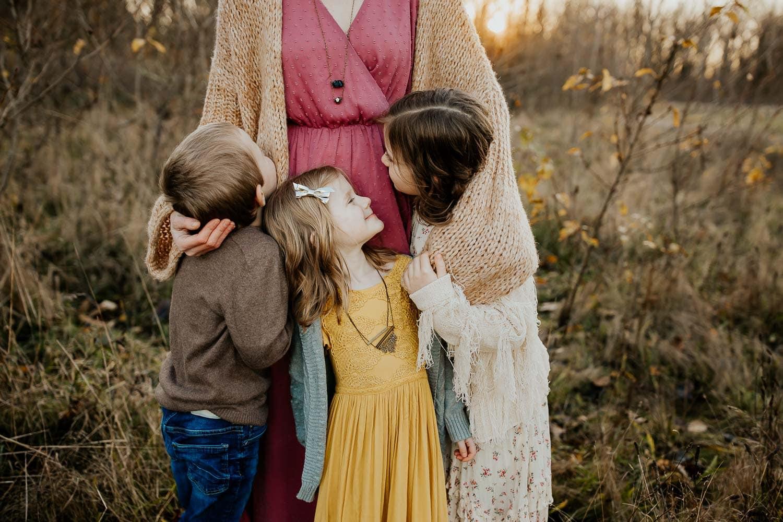 Mom hugging her three kids - best family photographer