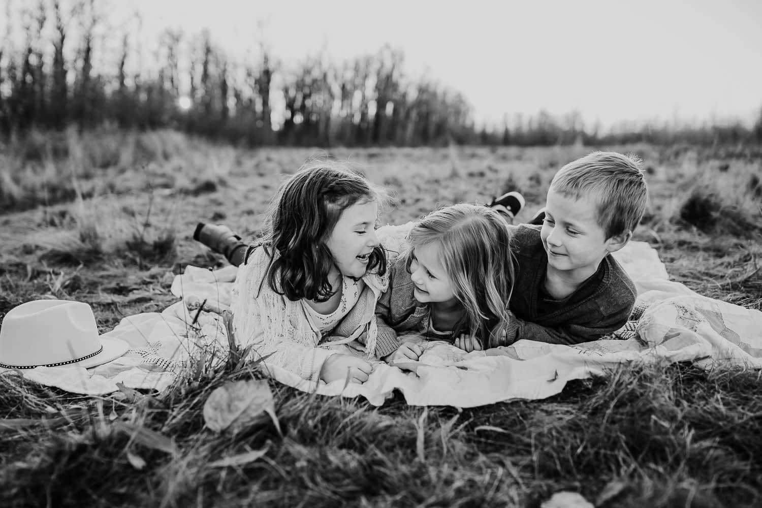 Kids laying on blanket together - best Portland family photographer