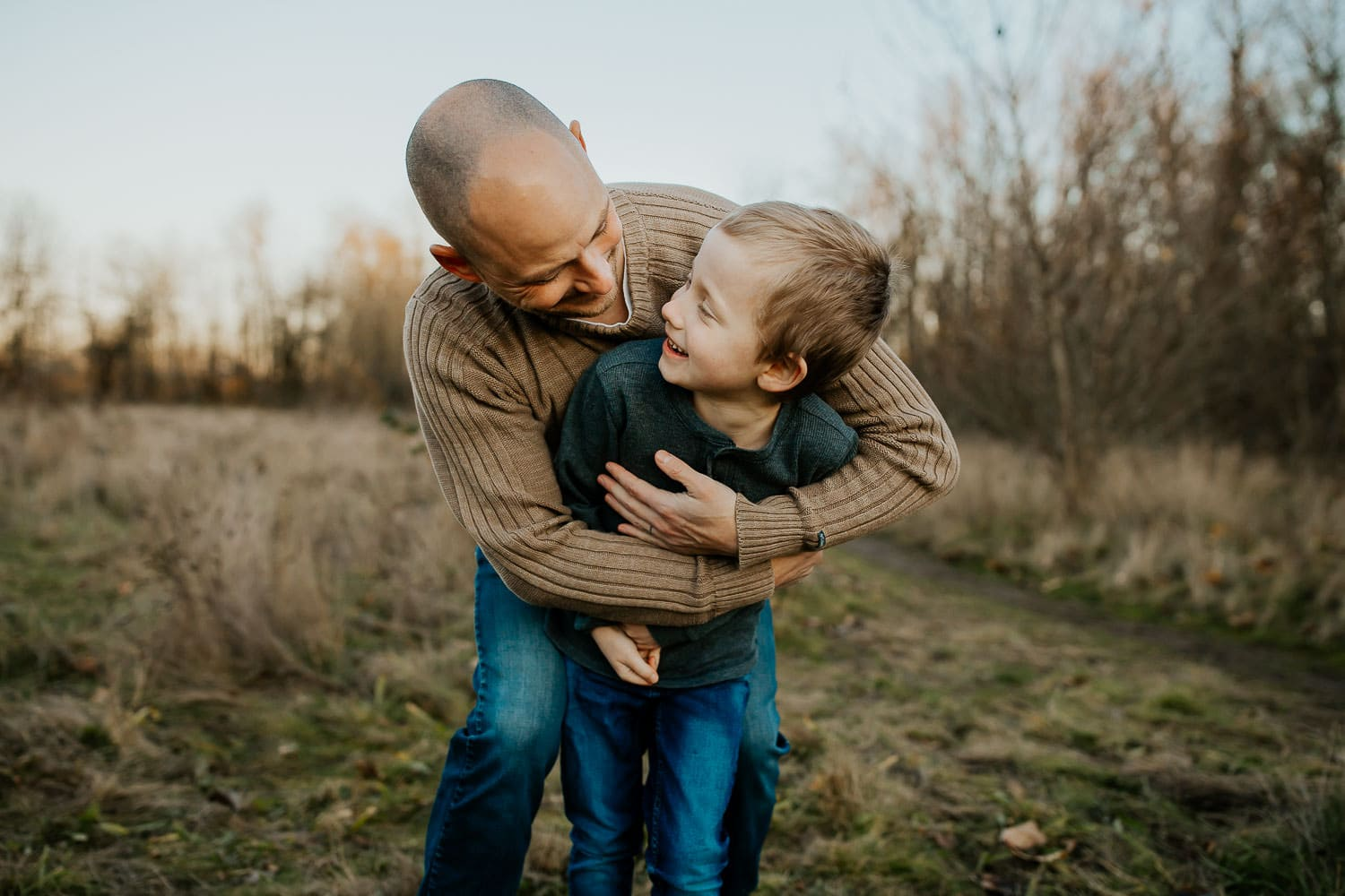 best portland photographer - Dad and son laughing together