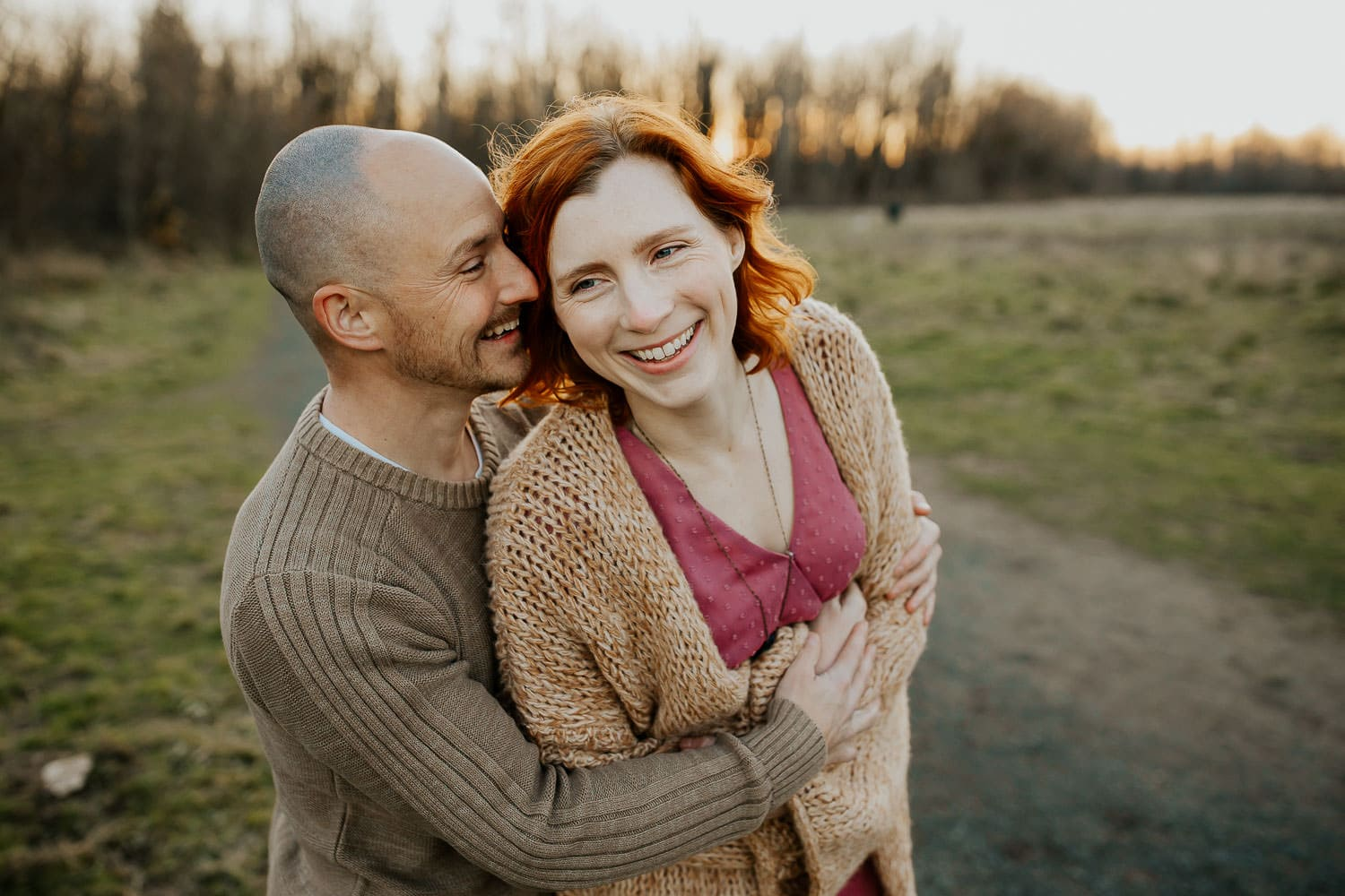 Parents holding each other and laughing - best Portland photographer