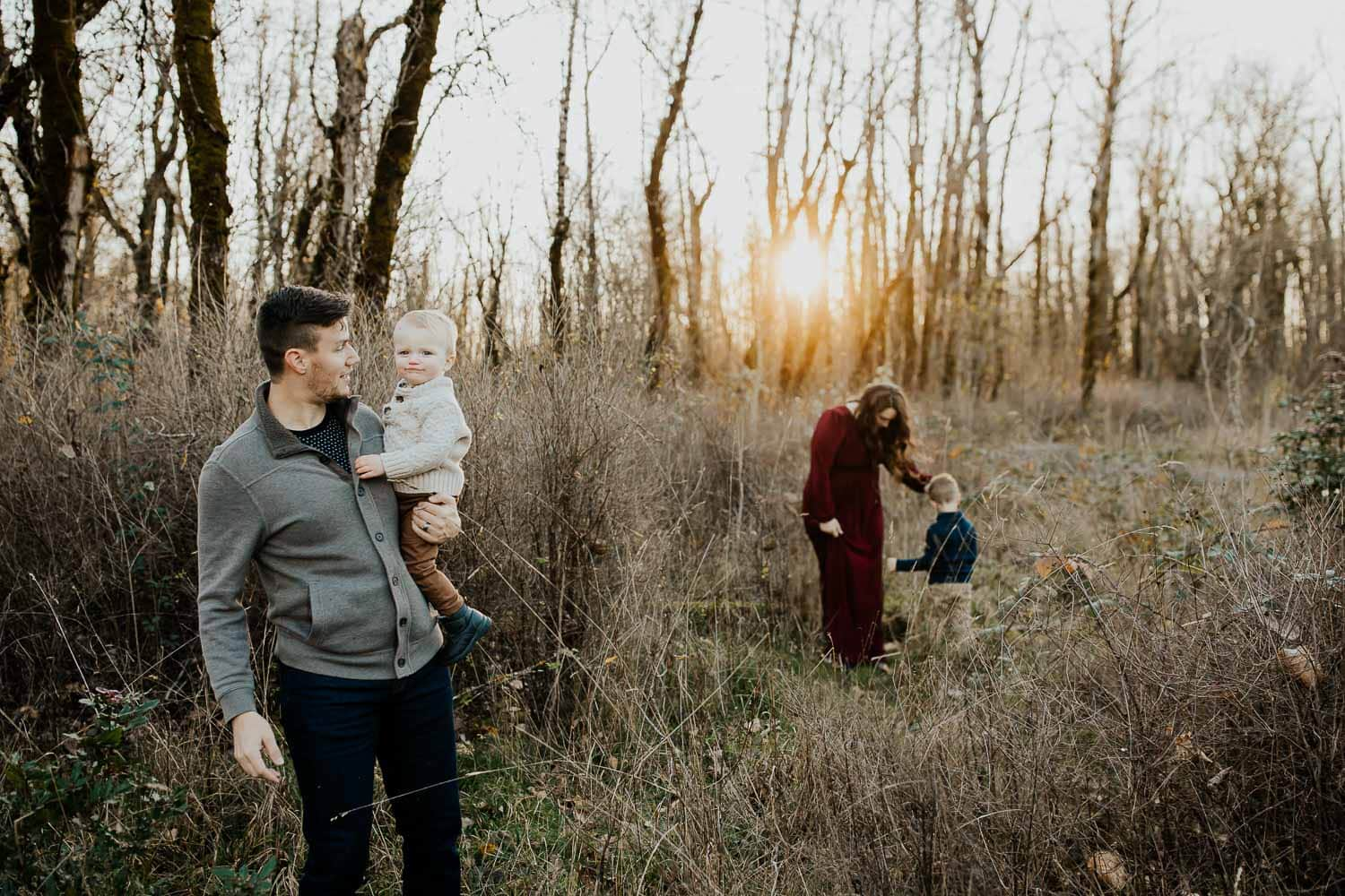 family of four exploring a park in the fall season