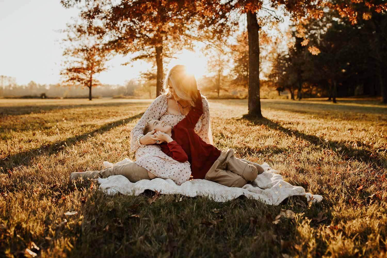 Fall season family photos - son laying in moms lap