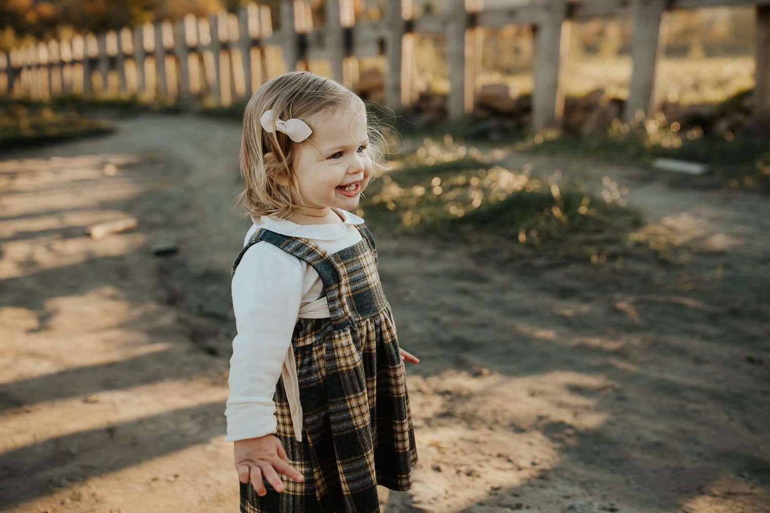 Adorable baby girl wearing plaid dress