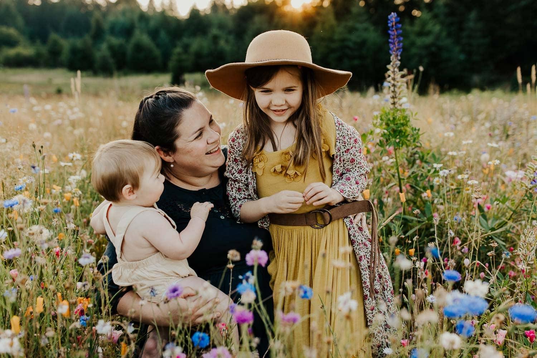 Family sitting in flower fields
