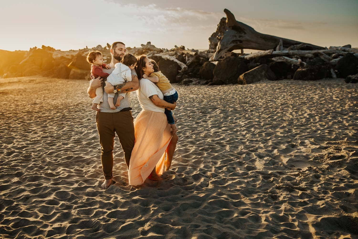 Family on the beach wearing muted colors and textures