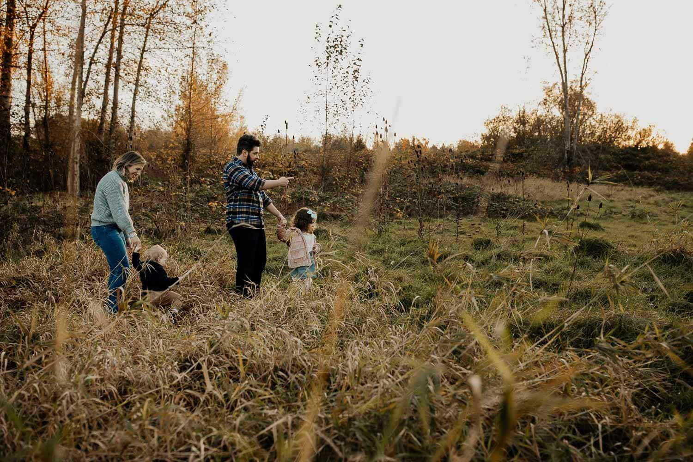 Family walking through tall grasses