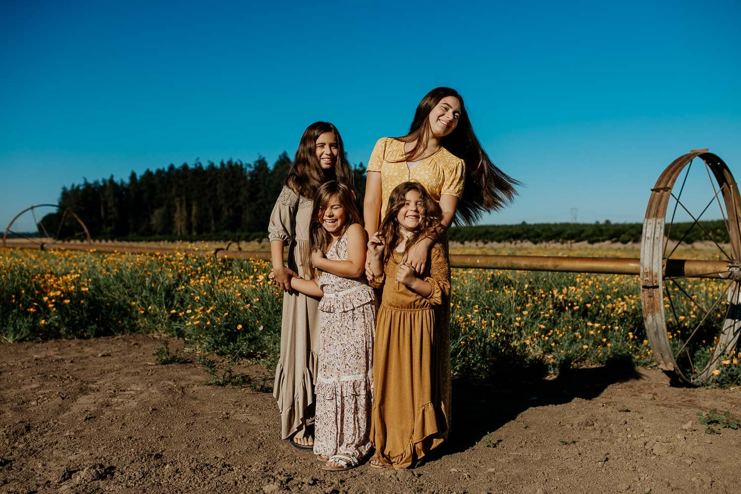 Sisters in a field of poppies - What to wear for photos