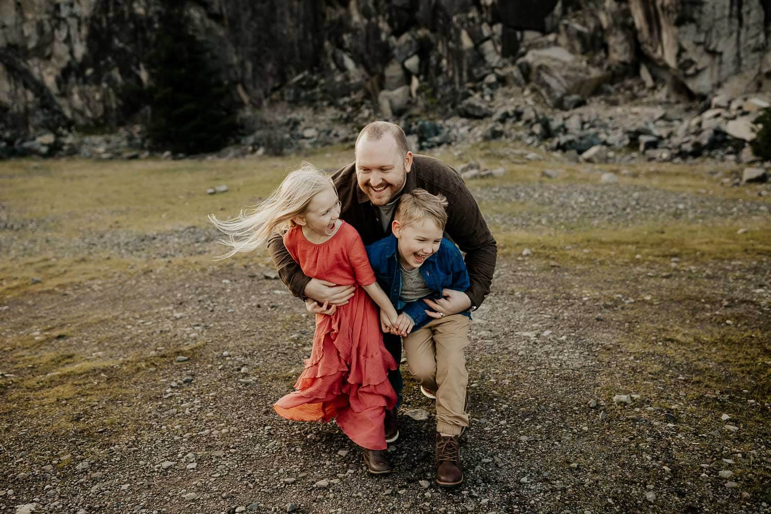 Dad with his two kids laughing in the gorge