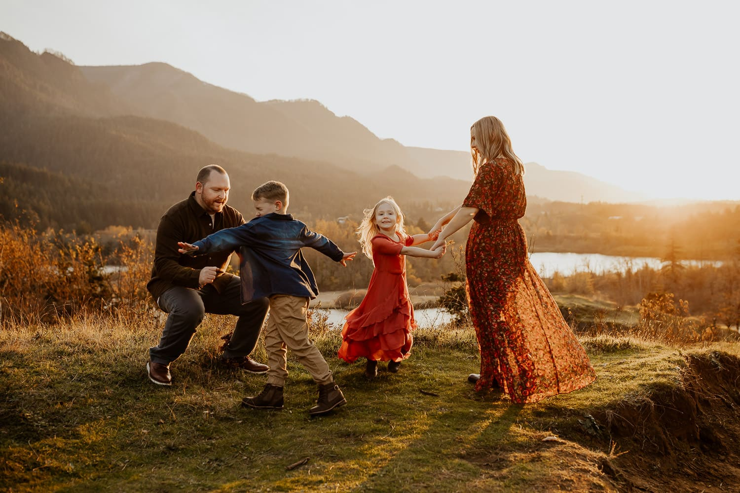 Family dancing with the columbia river gorge in the background
