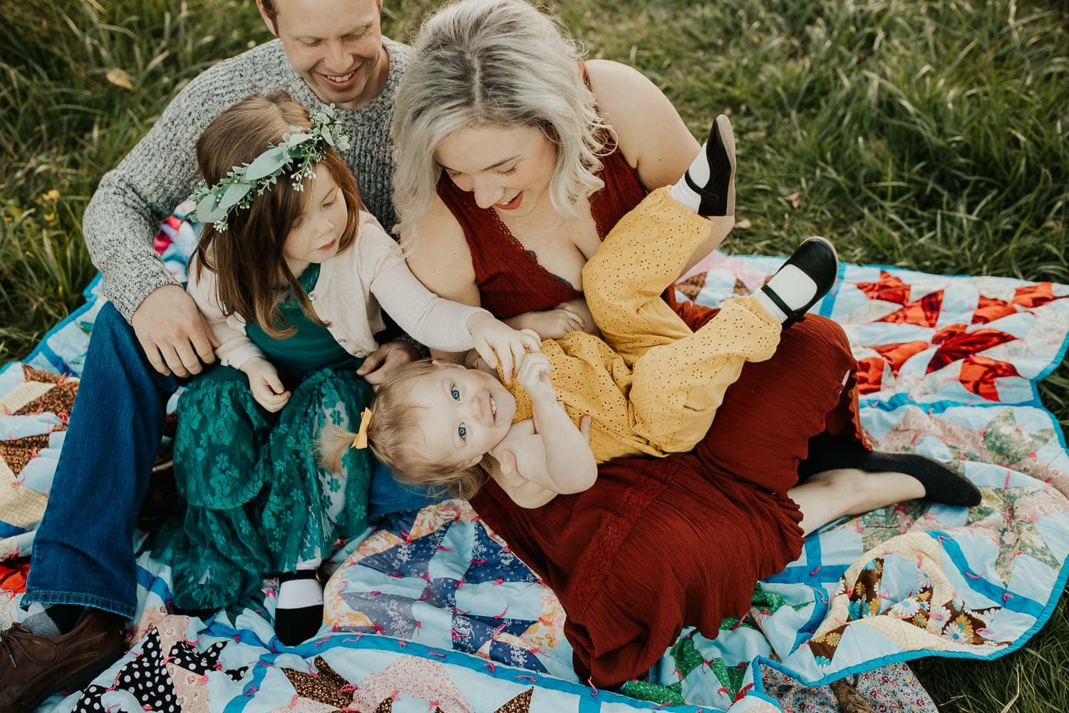 Family photos in portland oregon - family of four playing together on blanket wearing all textures without patterns