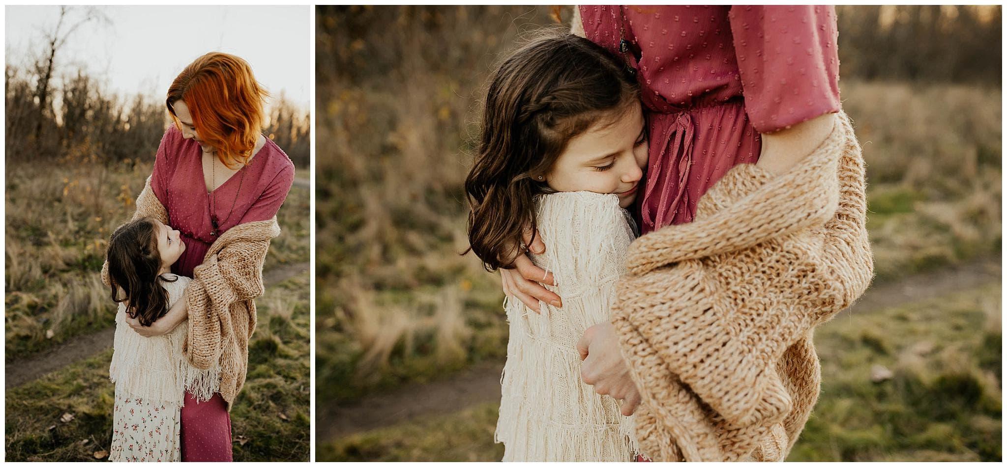 Little girl fiercely cuddling her mom