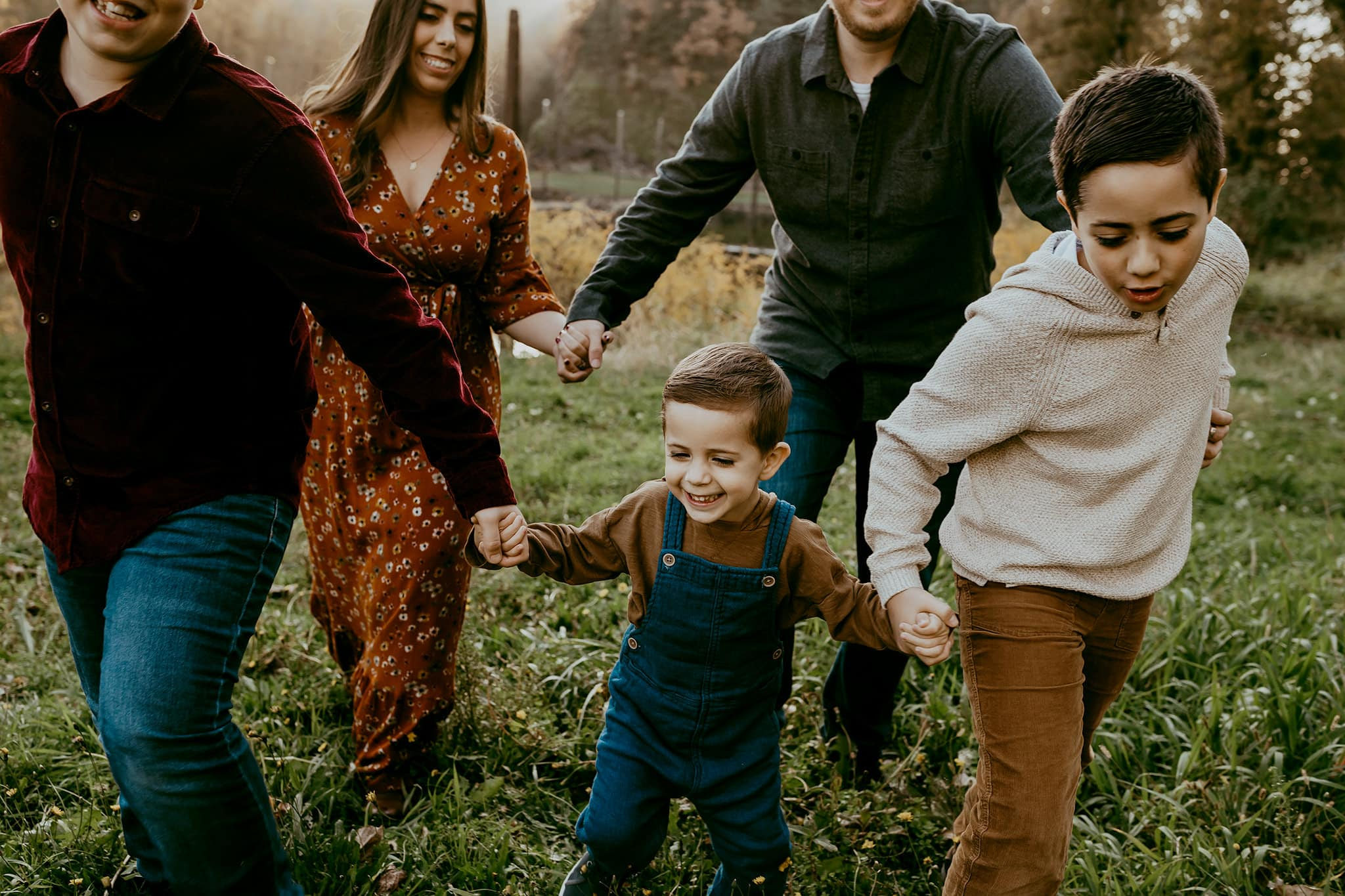 Family of five running after youngest brother