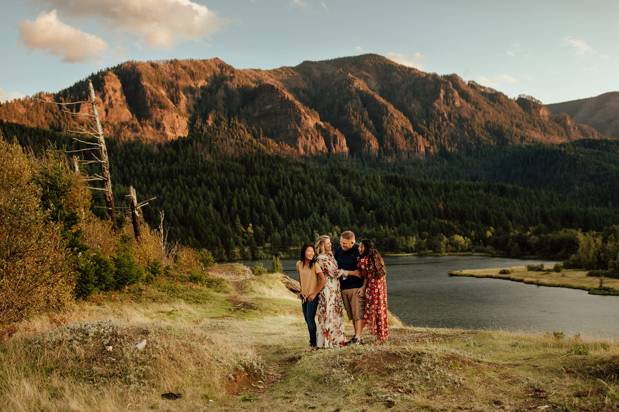 What to wear for family photos - family standing by a mountain
