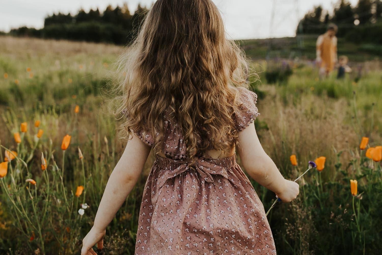 Little girl looking out over portland flower fields