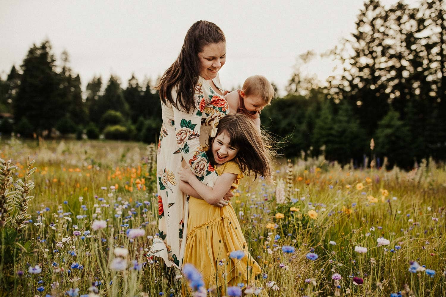 mommy and me session in a field of flowers