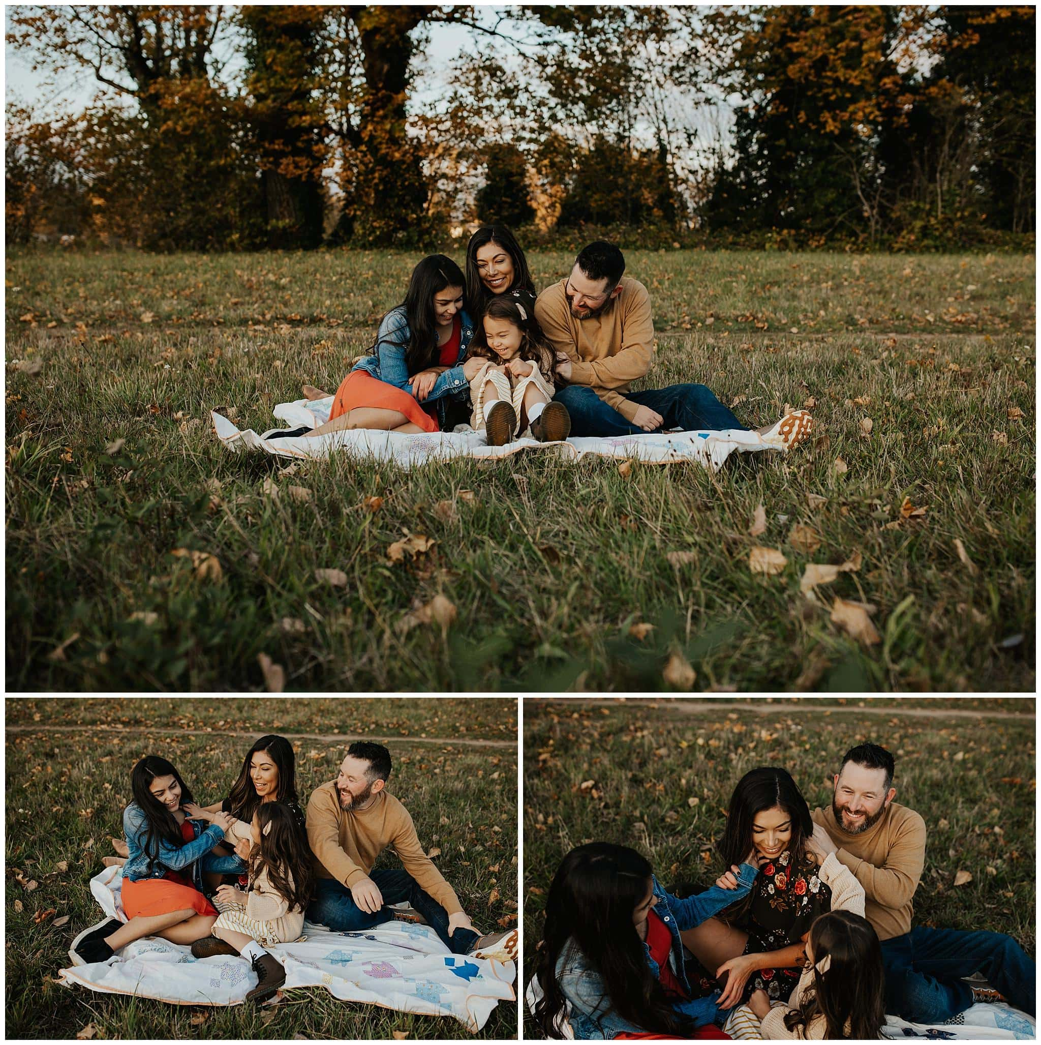 Family sitting on blanket and laughing together