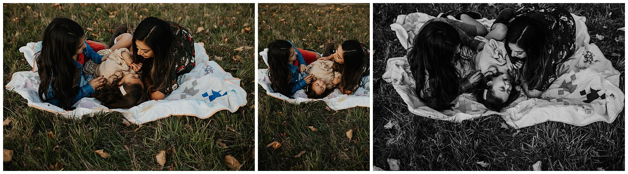 Mom and daughters laying on a blanket laughing - Family photo session in portland oregon