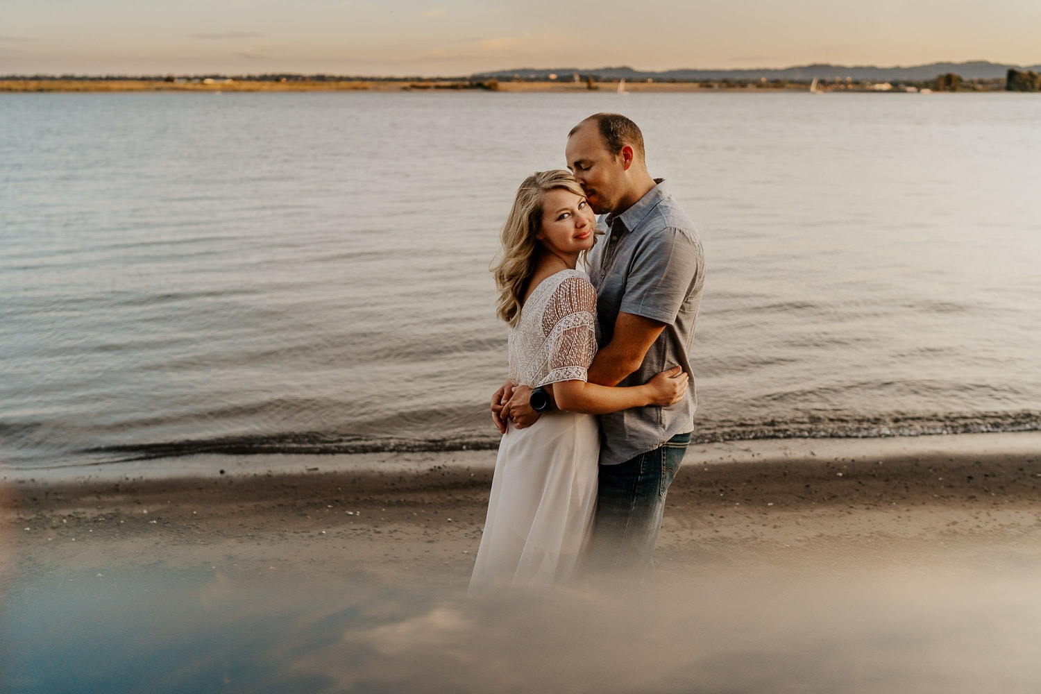 Couple embracing at a river location - Portland oregon couples photography